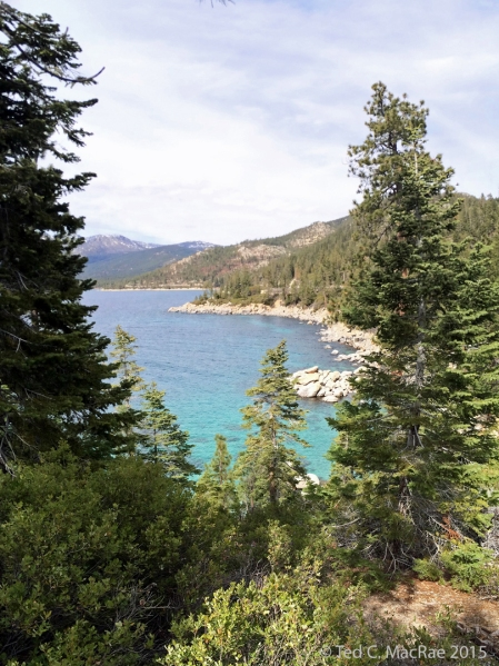 View from point just N of Sand Harbor. In contrast to the gentle slopes on the south, west and north shores, the east shore is steep and rugged and drops precipitously into the water's depths.